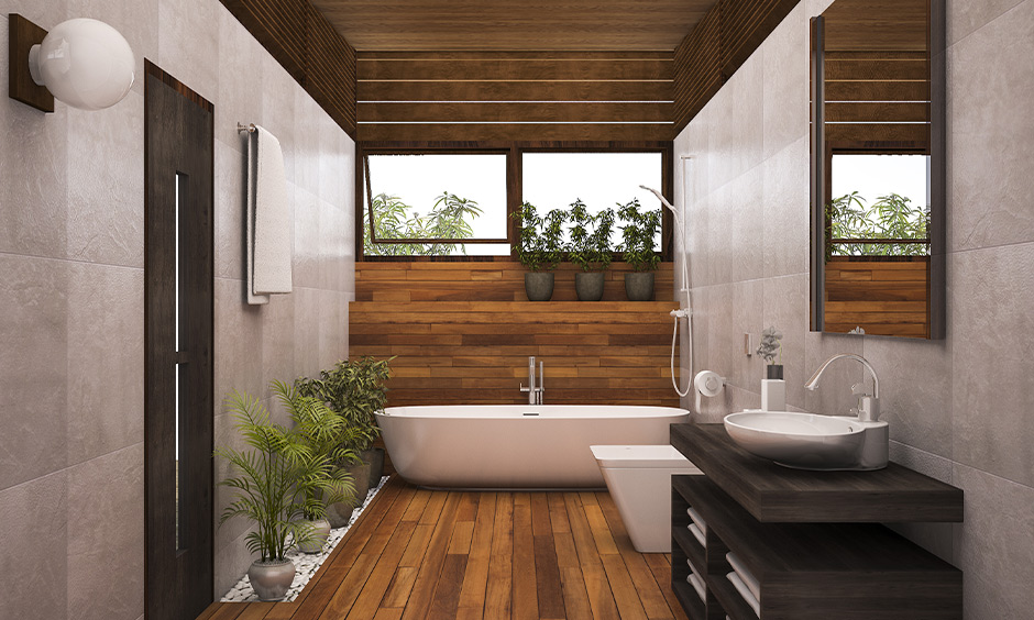 Wooden flooring best contemporary bathroom with bathtub and plants around it grant a warm look to the bathroom.