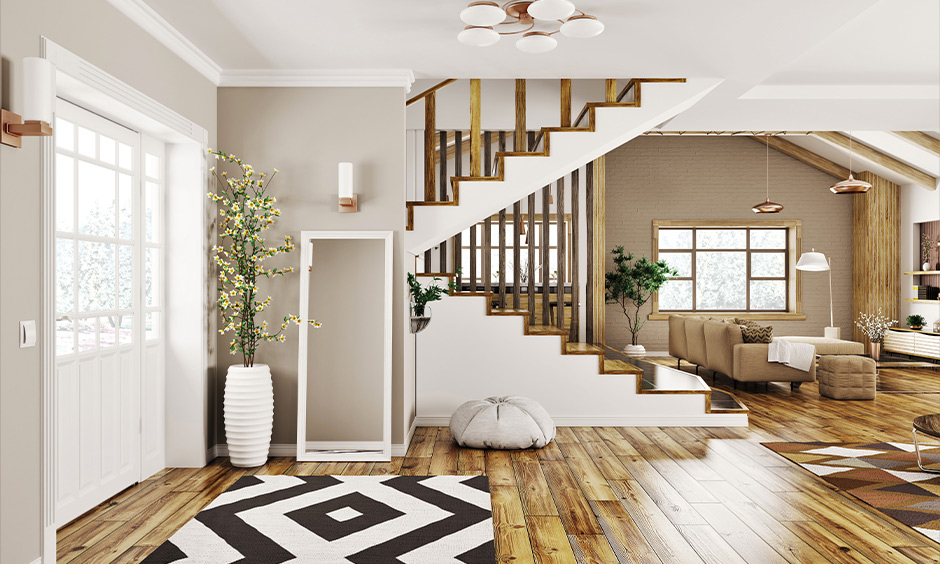 Ceiling to floor panel style wooden railing design turns ordinary-looking concrete steps into rustic and looks modern.