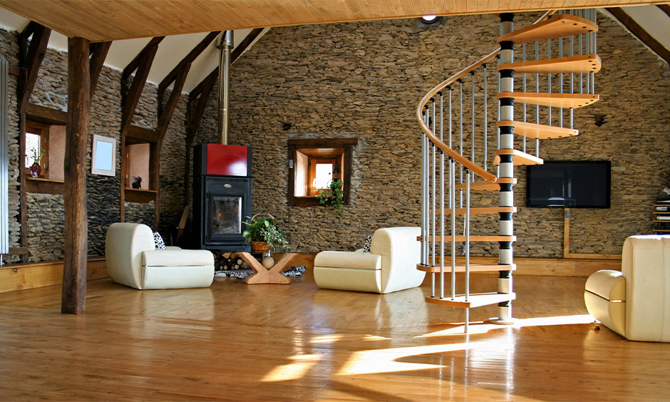 Steel and wooden railing pillar designs in a spiral shape look mesmerizing against the rustic limestone brick walls.