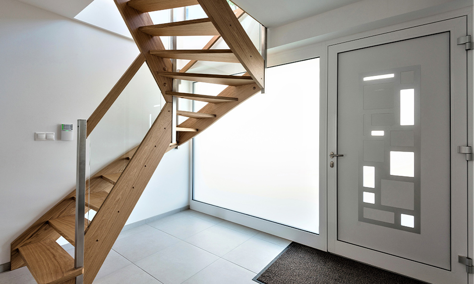 Steel and glass wood staircase lend a modern yet mid-century vibe to the hallway interiors.