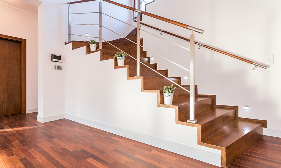 Steel rod-style with modern wood stair railing is the simplistic beauty of this entrance hallway excited.