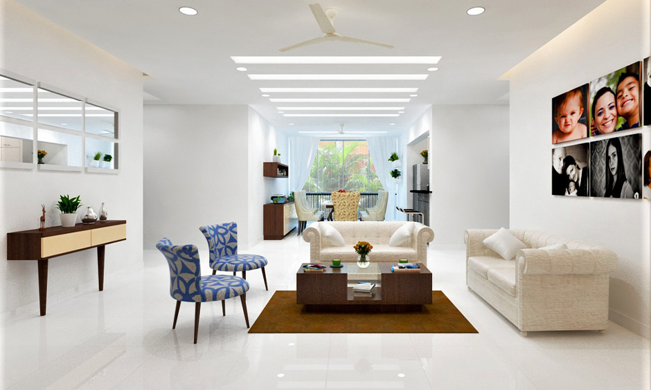 The recessed linear led decorative lights panel in this white living room are power-saving as well as space-saving.