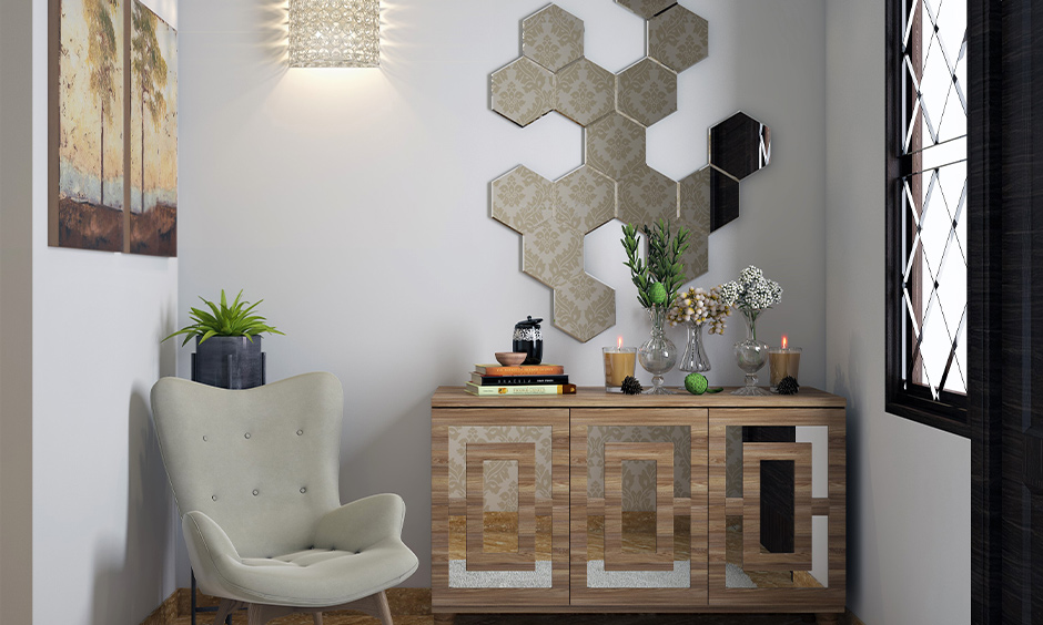 Modern sconce decorative wall light providing both uplighting and downlighting in this small foyer area adds a classy look.
