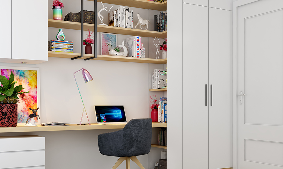 Clutter-free wall-mounted study table with bookshelf and shelves in white laminate is a stunning design.