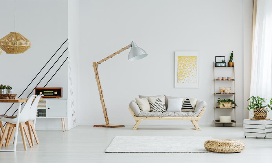 This uber-contemporary living room lamp in the corner with a wooden base and a metal shade looks classy and chic.