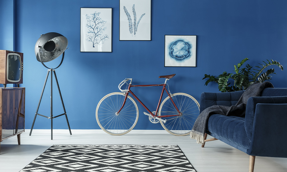 This stylish round lamp against the blue wall is the best lamp for the living room and looks elegant with a sofa.