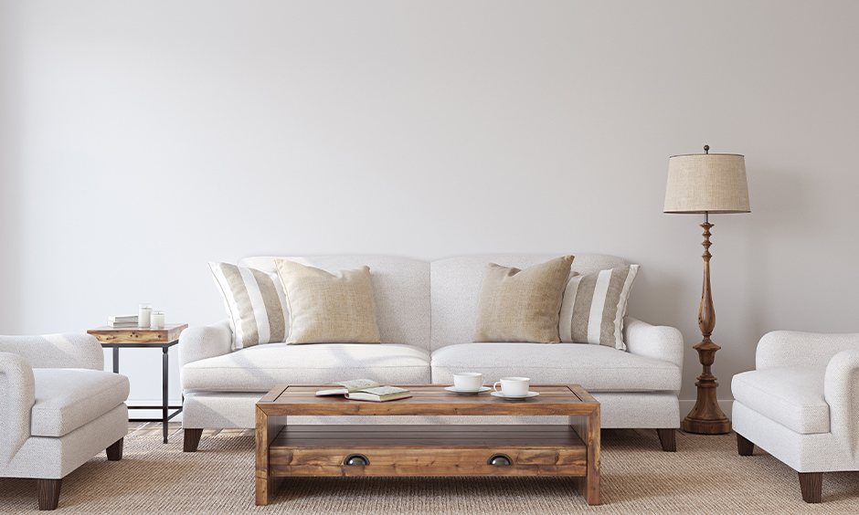 Vintage living room lamp next to the white sofa rich in design, layered brightness and subtle aesthete.