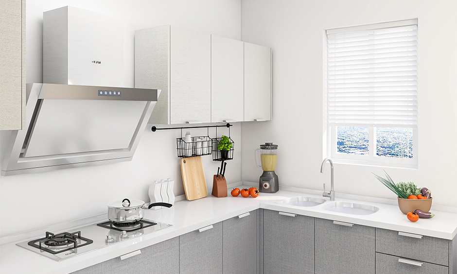Two burner kitchen hob and chimney is scratch-proof and easy to clean in this white kitchen and cabinet in grey colour.