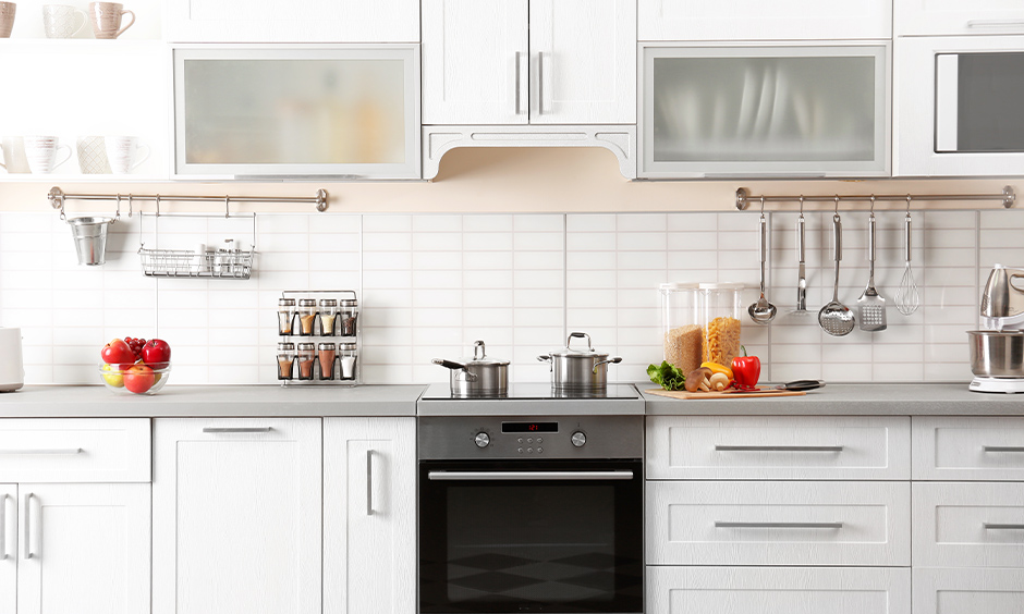 White kitchen with a modern technology induction cooktop that enhances the elegance of the area is the best kitchen hob.