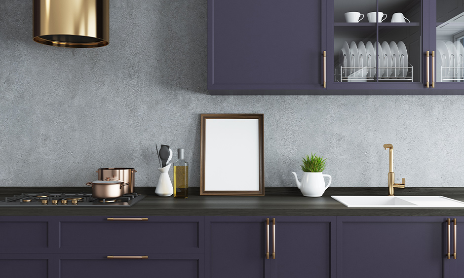 Rustic purple kitchen cabinets with grey wall design are minimal and bring vintage countryside kitchen vibes.