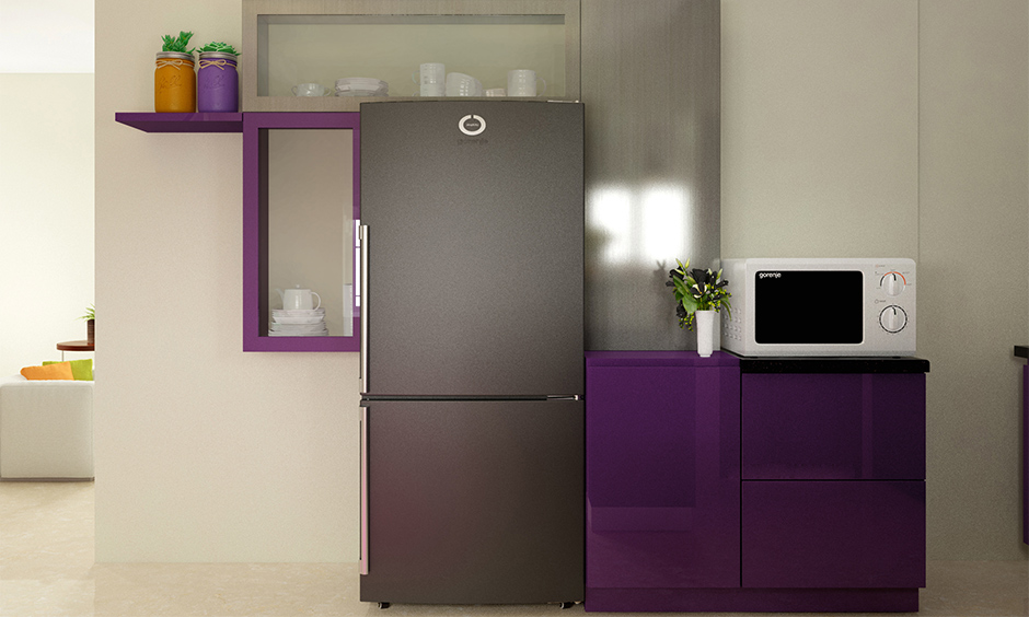 Contrasting shades of a purple colour kitchen with beige and grey add a personality to the kitchen.