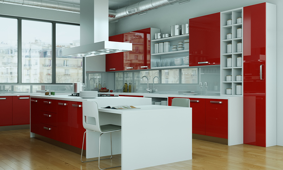 White kitchen with red colour cabinets lend an elegant appeal to the area is the red colour kitchen design.