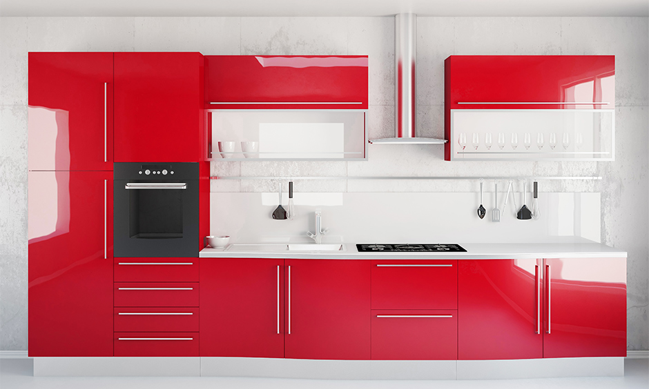 Whitewall kitchen and red cabinets look minimal and bold are the kitchen design red white.