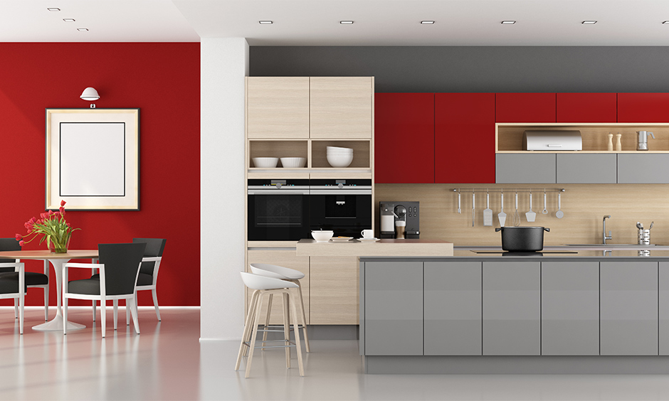 The combination of grey and red color kitchen design cabinets appeal along with a traditional Indian charm.