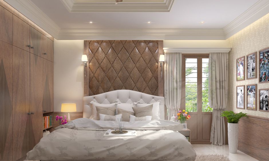 Master bedroom with white bedding and bedside wall lamps above the high headboard is simple yet elegant.