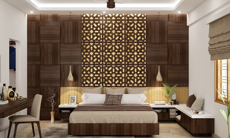 King-size bedroom with dome-shaped wall mounted bed lamps in metallic and has a gorgeous accent wall made from wood.