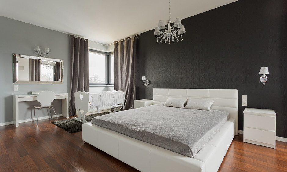 Victorian-style master bedroom with two-toned walls and wall mounted lamps for bedroom in white on each side look elegant.