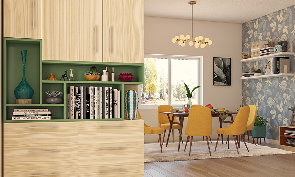 Dining room with bold yellow chairs and hanging lights resemble balloons are the hanging lights for dining room India.