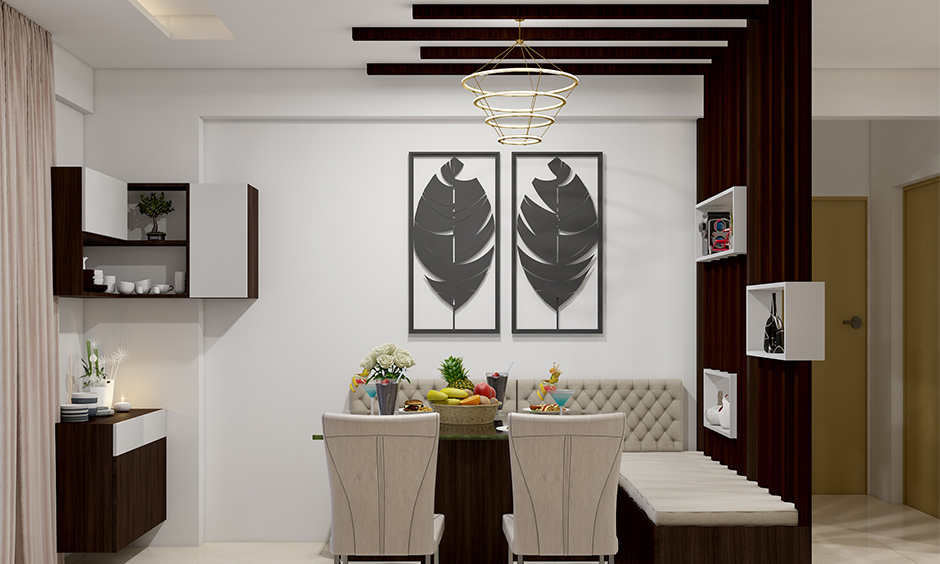 Dining false ceiling designed in dark wood panels with drop-down lighting adds to the overall vibe of the dining room.