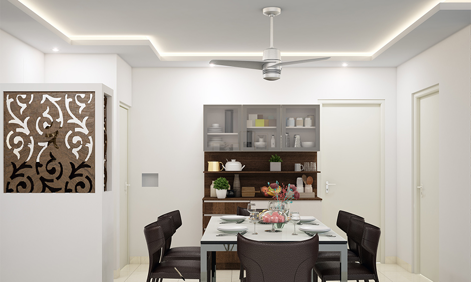 White dining room false ceiling designed with cove lighting is perfect for an excellent experience for a party.