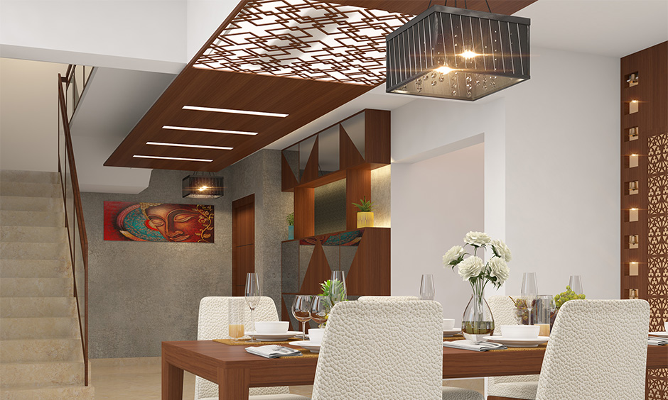Dining room ceiling design made using timber and glass combination in an intricate pattern with hanging light looks rustic.