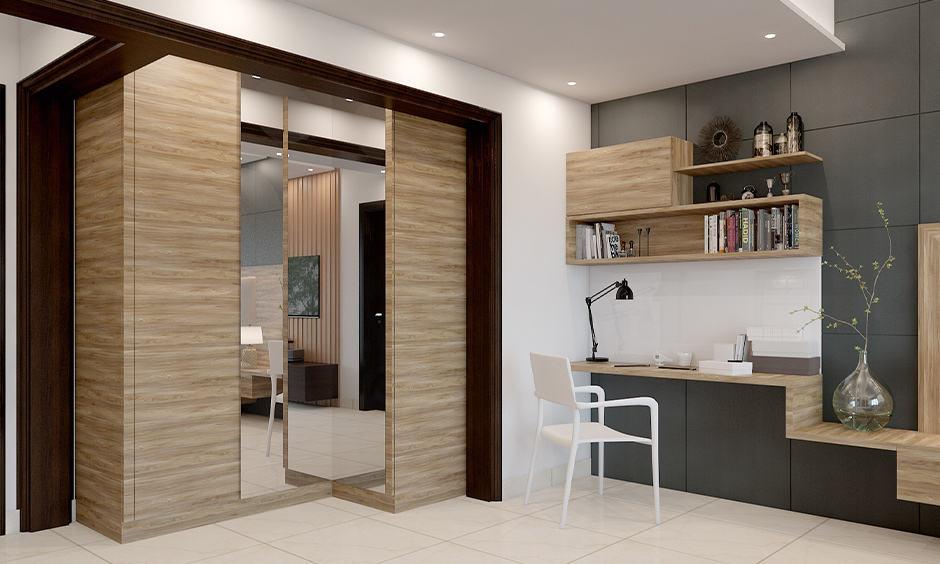 Bedroom wooden almirah design with a mirror