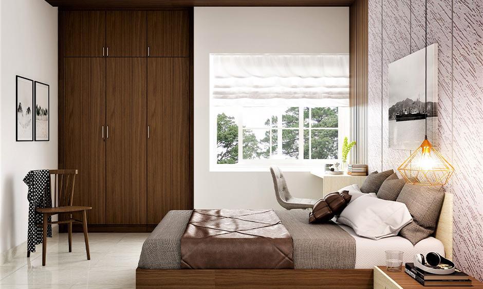Floor-to-ceiling built-in wooden almirah design