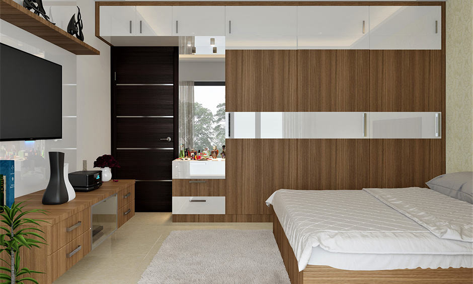 Wooden almirah with an attached dressing table in bedroom