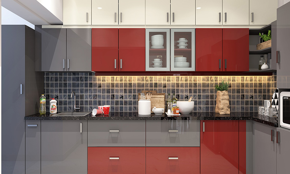 Red and grey laminate shutter kitchen cabinets finish in this kitchen is durable, smooth and moisture/scratch-resistant.