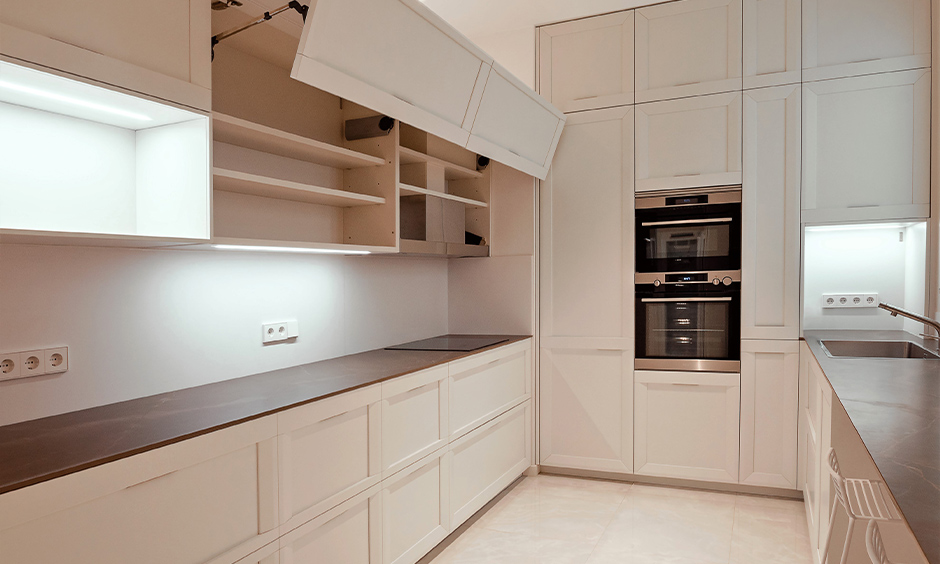 This parallel white kitchen has a lift-up kitchen shutter door for space-saving and cleaning it is easy-peasy.