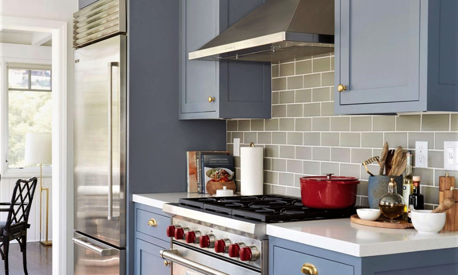Grey coloured cabinets in this kitchen profile shutter design in swing very convenient to use and durable.