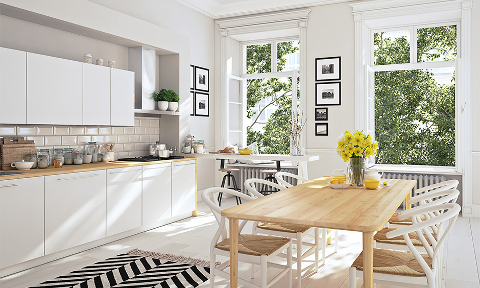 This dining cum white contemporary kitchen design with two windows brings in all the light and hassle-free.