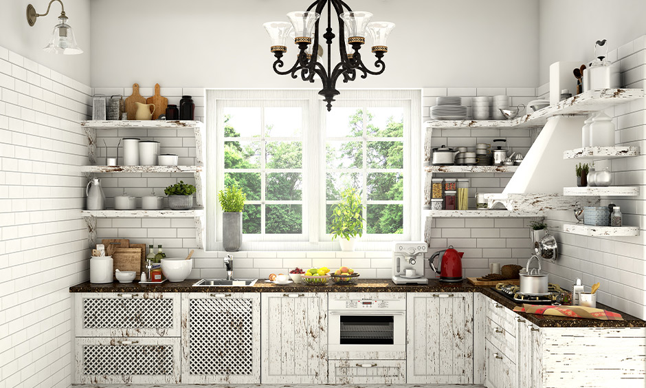 This vintage l shaped kitchen design with the window in white makes the joy of cooking feel and look chic.