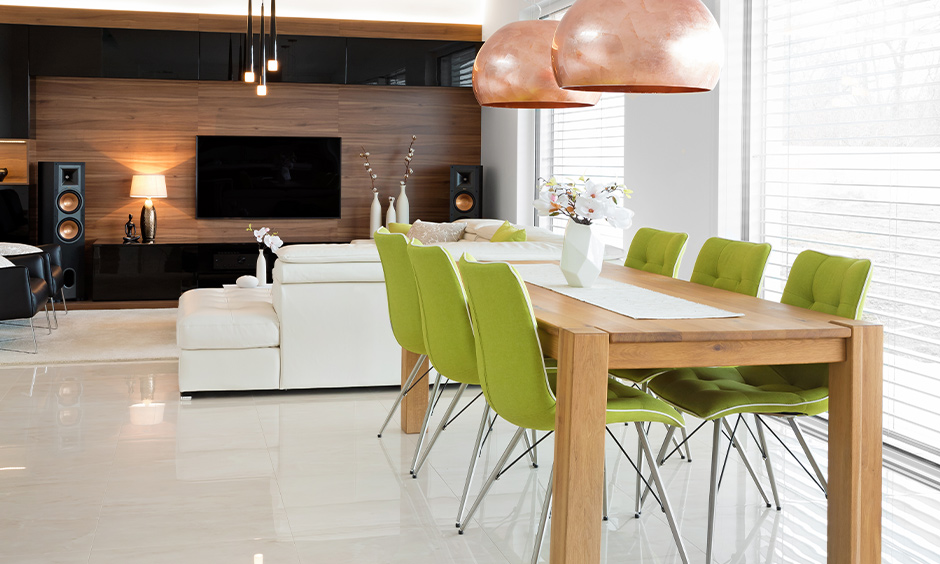Living cum dining area with a wooden table and six chairs in bold colour brings a fresh vibe is stackable dining room chairs.
