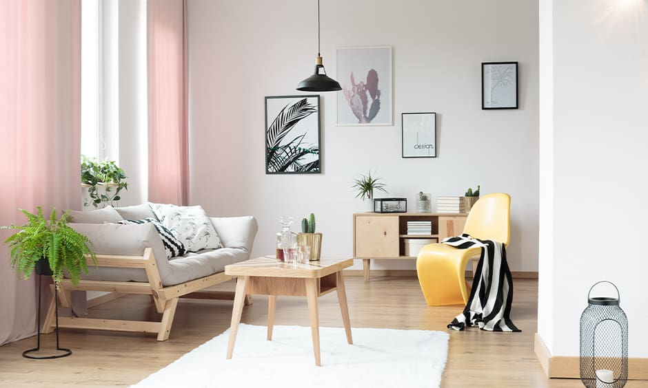 White walls and pink curtains bring in textures with various textiles
