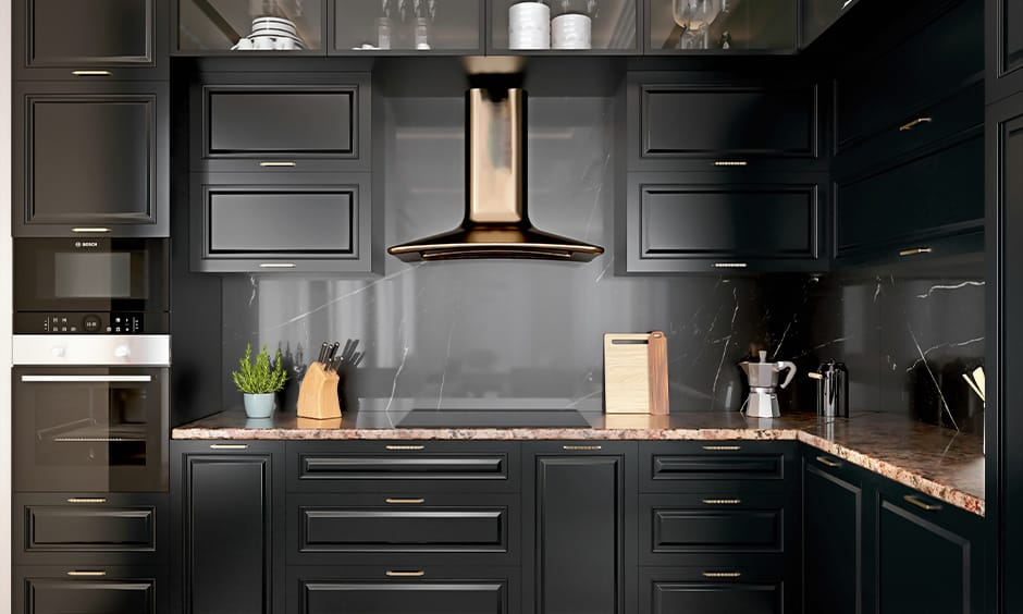 Modern kitchen design with floor-to-ceiling black cabinets provide storage spaces