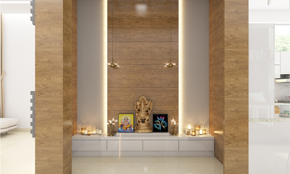 Pooja lights behind the wooden back panel which looks great and at the same time makes sure it emits sufficient light.