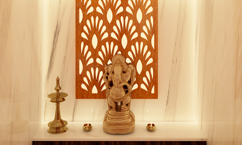 Pooja room has a traditional wooden back panel and recessed pooja mandir lights that gives a warm yet bright light.