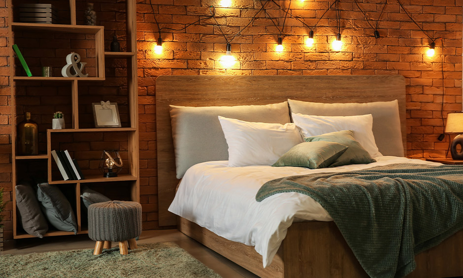 Brick wall with hanging fairytale lights in the bedroom and comes with bookshelves brings the rustic vibe.