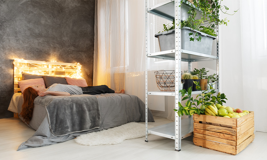 Grey and white bedroom comes with a queen-size bed and wooden headboard with fairy lights bedroom decor.
