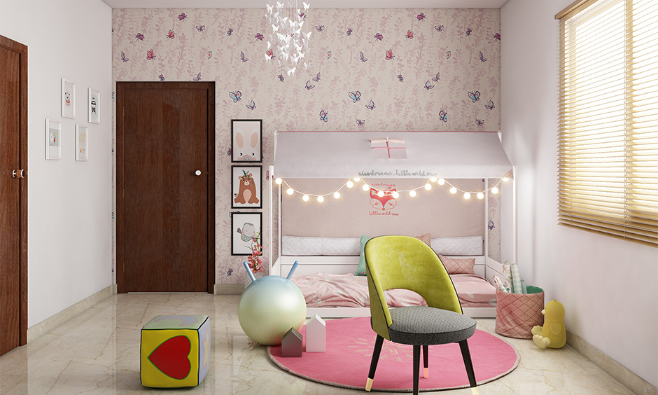 Pink theme kids' bedroom with fairy lights arranged in a row across the daybed canopy is the fairy lights bedroom decor.