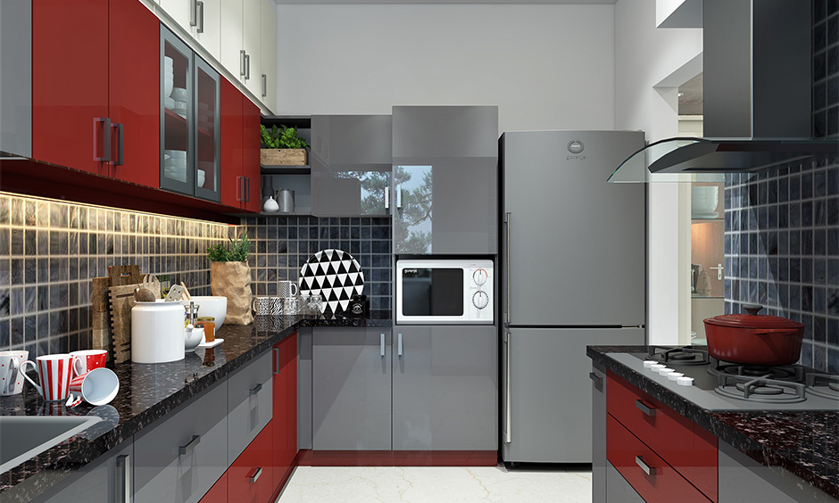 Black pearl granite kitchen countertops complement the grey and maroon cabinetry and look classy and lively vibe to space.