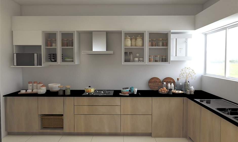 Jet black granite countertops along with the brown cabinets bring in a contemporary vibe to the l-shaped kitchen.