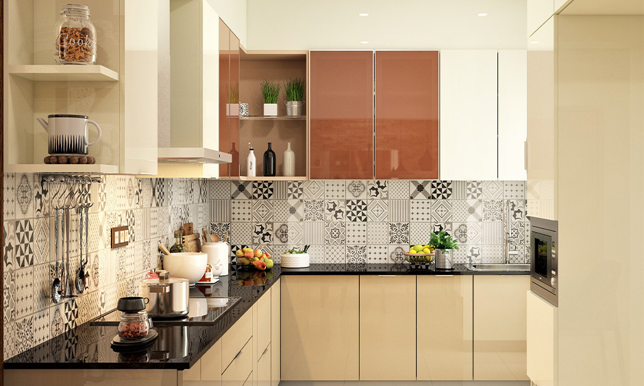 Polished black granite countertops and cream coloured cabinets lend a strong and bold character to the kitchen.