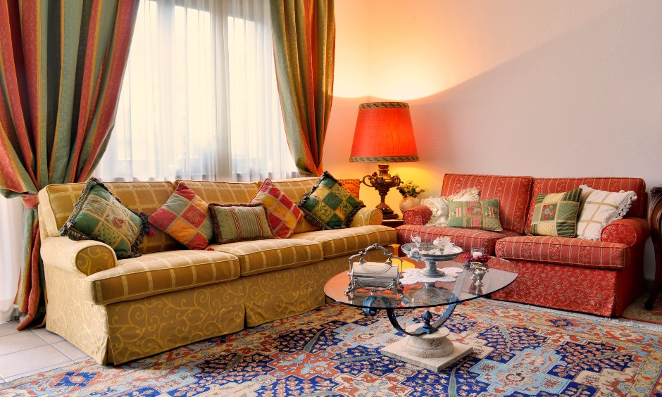The colourful drapes add to the beautiful riot of colours in the area are the modern curtain designs for living room.