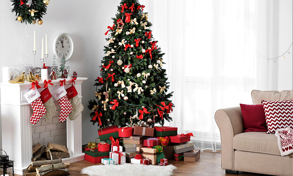 White living room decorating Christmas tree with ribbon and tree ornaments look vintage, also bring a fun and festive vibe.