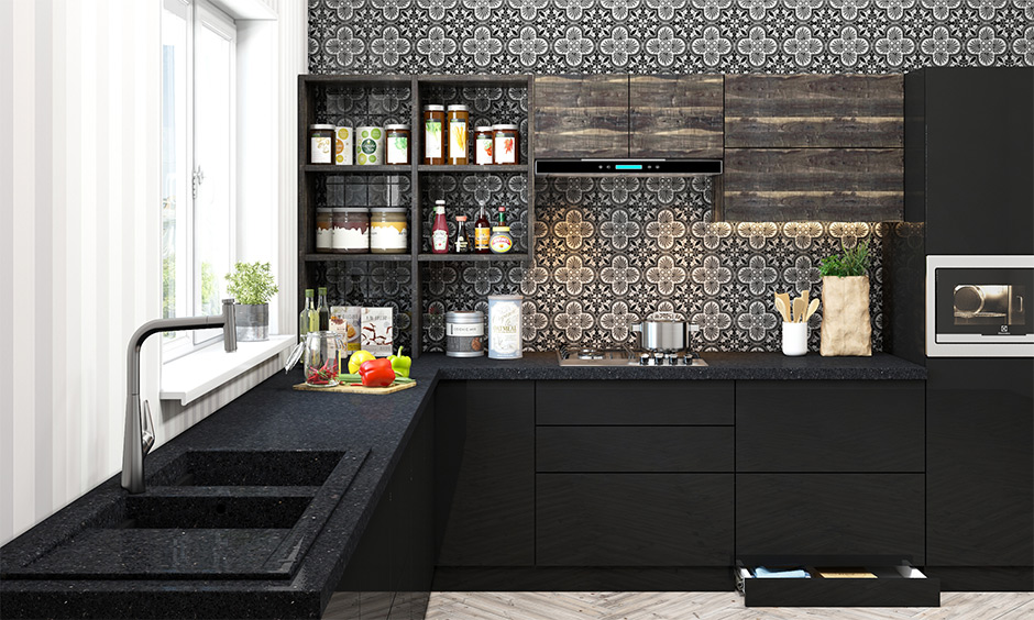 Bold black granite quartz kitchen sink and black slab in the l-shaped kitchen are odour-resistant and super hygienic.