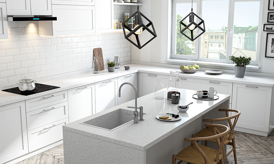 Best quartz kitchen sink in frosty white island kitchen, it has white drawers and white cabinets for easy storage.