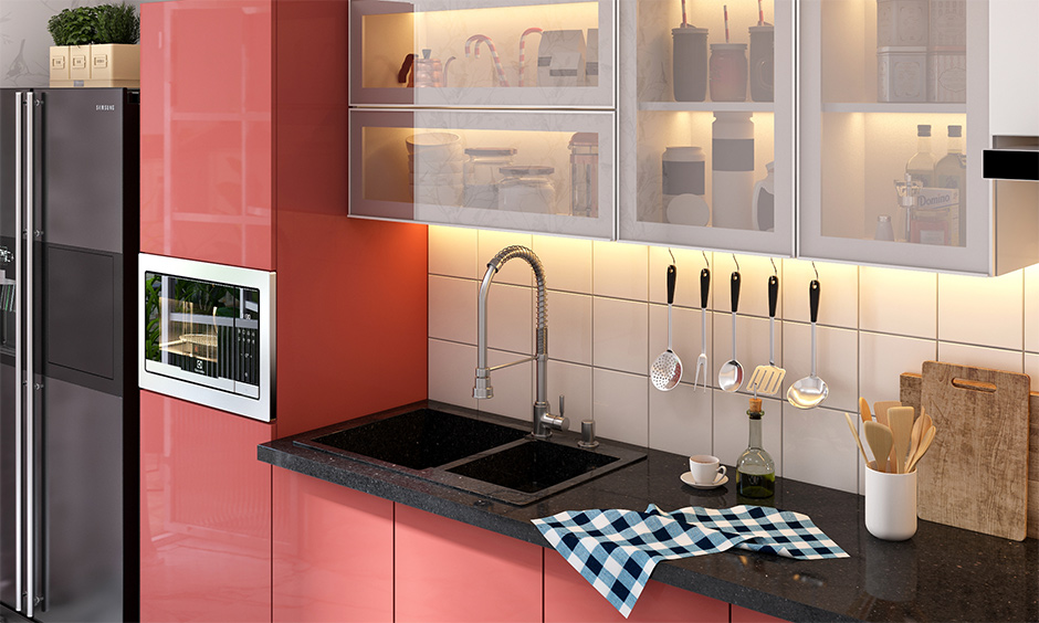 Dual quartz kitchen sink in India in black has back-panel lighting and elegant slab in black, which adds to the look.