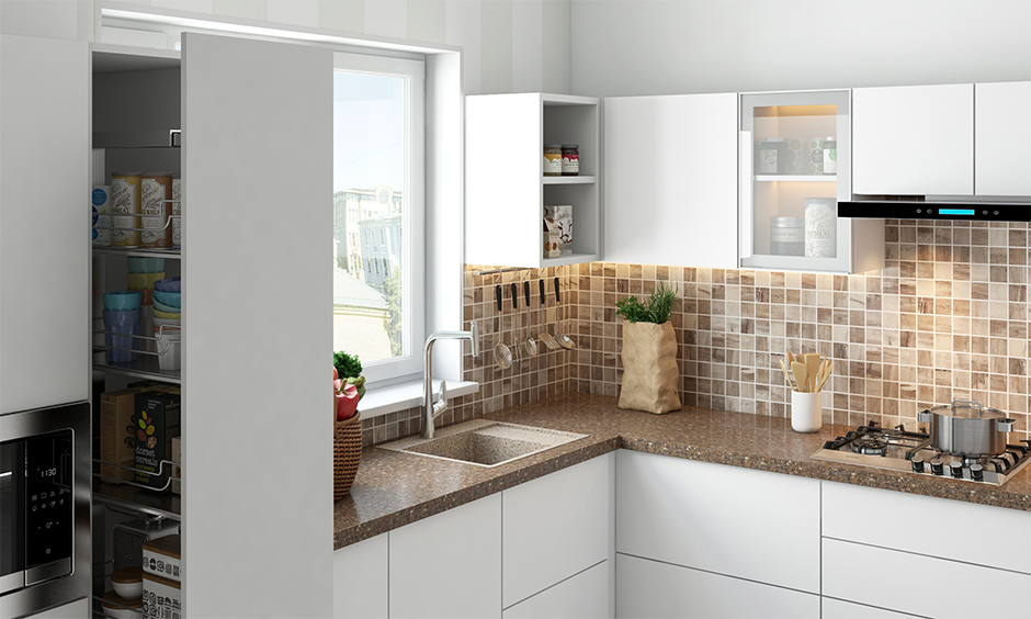 Quartz integrated kitchen sink in the brown shade with slab and small mosaic tiles in white kitchen.